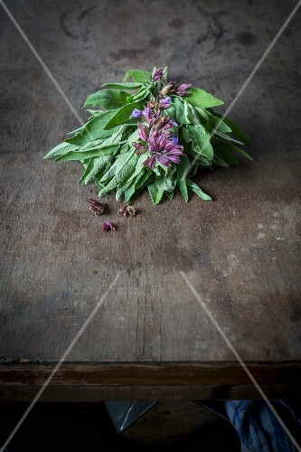 A bundle of flowering sage on a wooden table