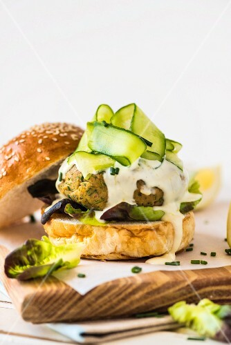 Tuna fish chickpea burger with lemon mayonnaise and cucumber strips