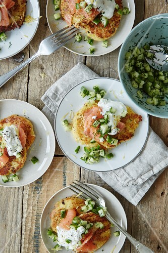 Potato cakes with salmon, cucumber and sour cream