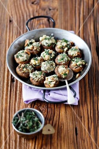 Baked mushrooms stuffed with blue cheese, walnuts and parsley