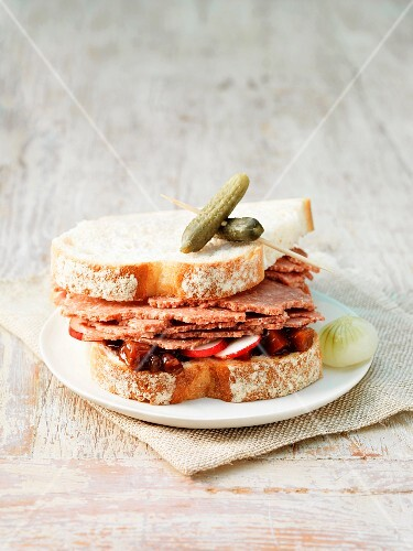 A corned beef, gherkin and radish sandwich