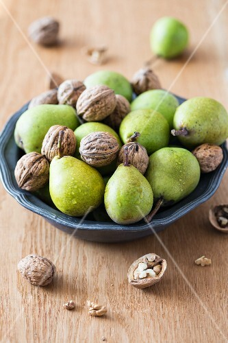 Fresh pears and walnuts in a bowl