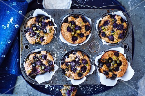 Blueberry muffins in a muffin tin seen from above