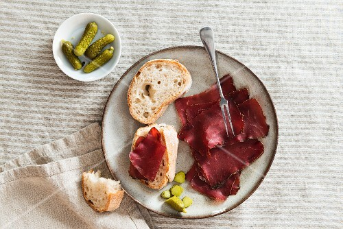 White bread with Grisons air-dried beef and gherkins