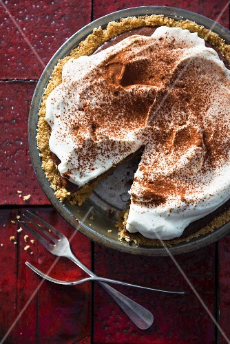 Chocolate pie with cream and cocoa powder