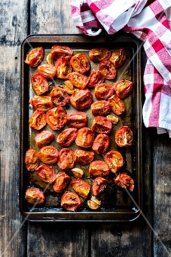 Roasted tomatoes on a baking tray