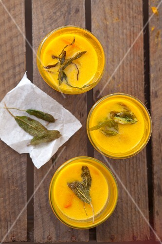 Pumpkin and coconut soup with fried sage leaves (seen from above)