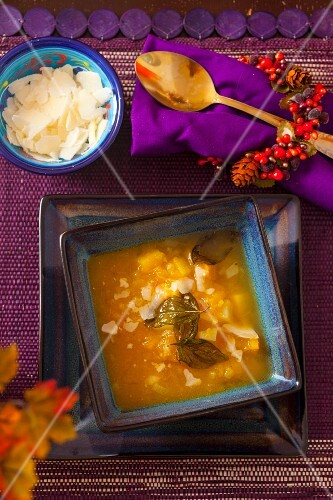 Pumpkin soup with Parmesan cheese and fried basil leaves