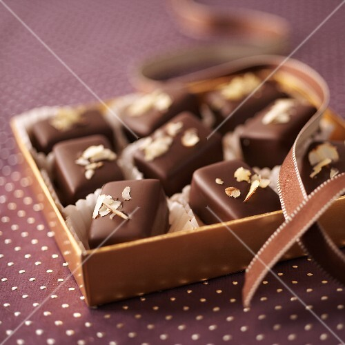 Chocolate and nut pralines in a gift box