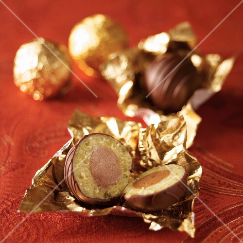 Mozartkugeln (pistachio marzipan and nougat coated in chocolate) in gold foil