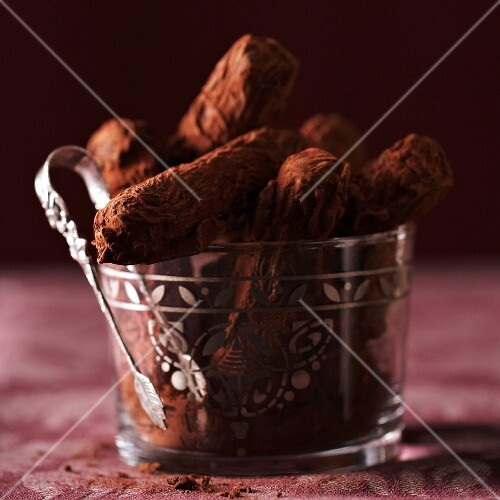 Dried plum sticks with cocoa powder