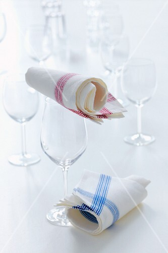 Empty glasses and tea towels