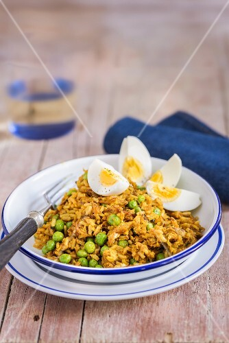 Kedgeree with peas and hard-boiled eggs (England)