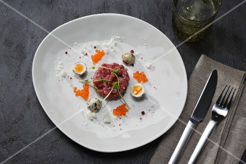 Beef tatar with quail's eggs and caviar