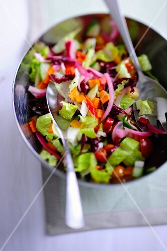 Mixed leaf salad with chopped vegetables in a salad bowl