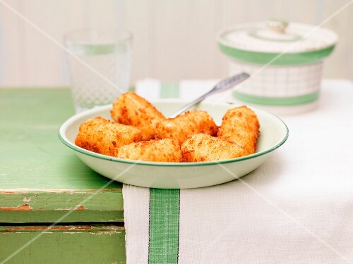 Potato croquettes on a lime-green, ceramic plate