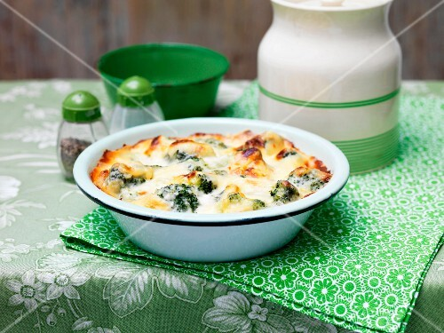 Broccoli and cheese bake in a ceramic dish