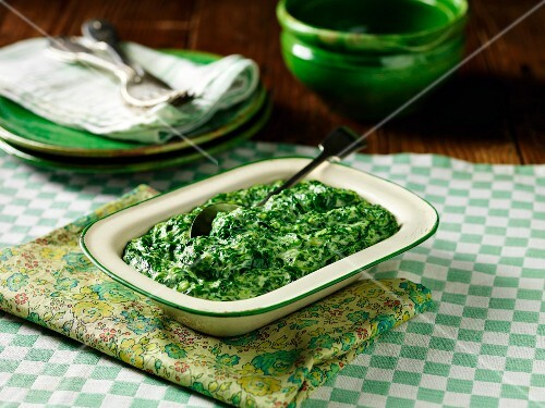Creamy spinach in a ceramic dish