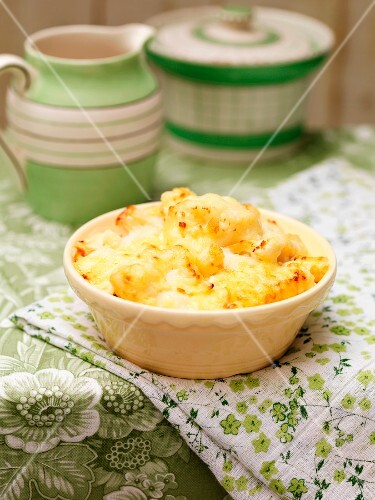 Cauliflower cheese in a round baking dish