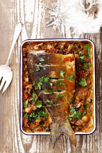 Baked carp stuffed with buckwheat and mushrooms for Christmas