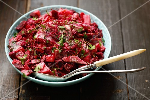 Herring with beetroot, potatoes, cream and beetroot sprouts
