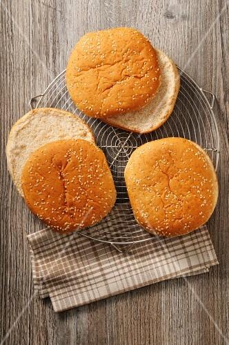 Three burger buns on a cooling rack
