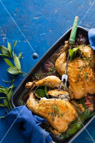 Roast chicken with bay leaves and garlic