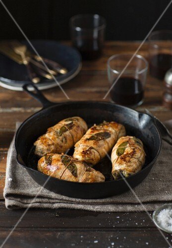 Stuffed chicken breast with sage in a pan