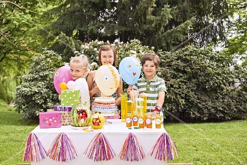 Children at birthday party in summery garden