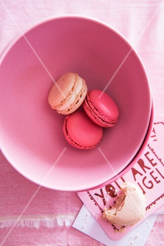 Pink macaroons in a bowl