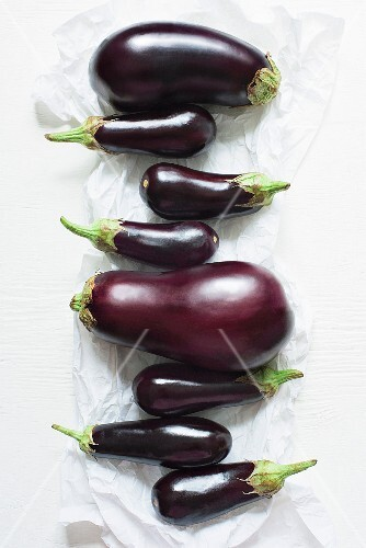Various different sizes of aubergines