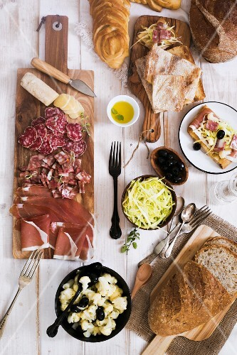 Various types of antipasti and bread (Italy)