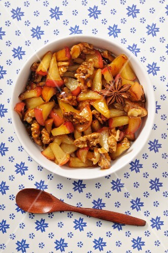Apple compote with caramelised nuts and star anise