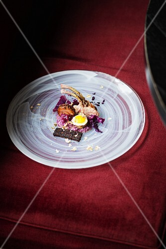 Young piglet with red cabbage risotto at Carte Blanche, Frankfurt am Main, Germany