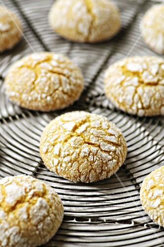 Lemon crinkle cookies on a wire rack