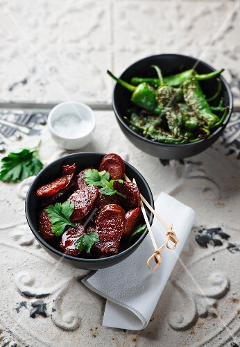 Spanish tapas: roasted chorizo and fried chilli peppers