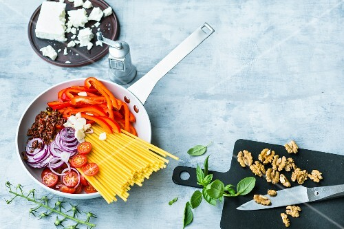 Ingredients for a one pot pasta dish in a pan