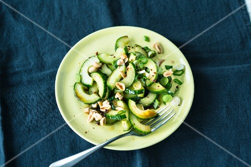 Cucumber salad with spring onions and peanuts (Asia)
