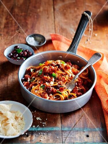 Spaghetti with Italian sausage and Ligurian olives