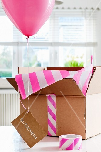 Balloon, gift voucher and open box