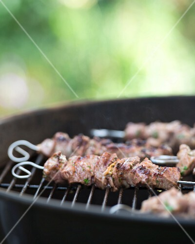 Grilled lamb kebabs on a barbecue