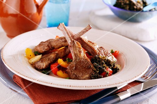 Lamb chops on a pepper medley with tapenade