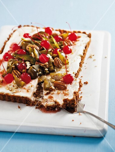 Christmas fruit flan with glacé cherries and pecan nuts