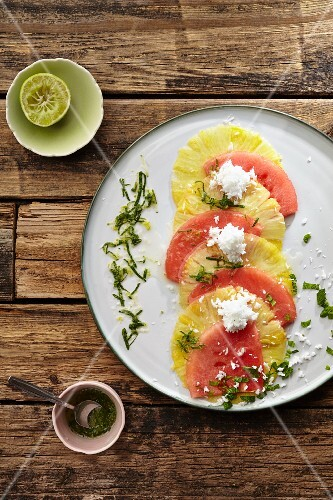 Watermelon and pineapple carpaccio with grated coconut, lime and mint