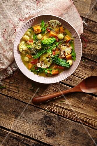 Sweet potato curry with rapini, cauliflower and macadamia nuts