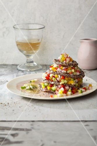 Colourful vegetable salad in a rape seed oil marinade with crispy flaxseed wafers