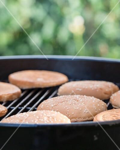 Burger buns on a barbecue