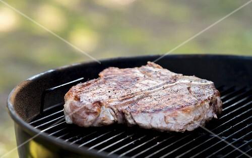 Porterhouse steak on a barbecue