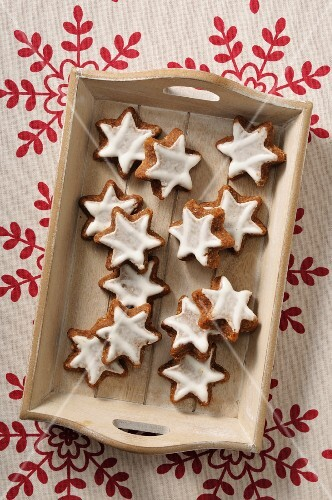 Cinnamon stars on a wooden tray