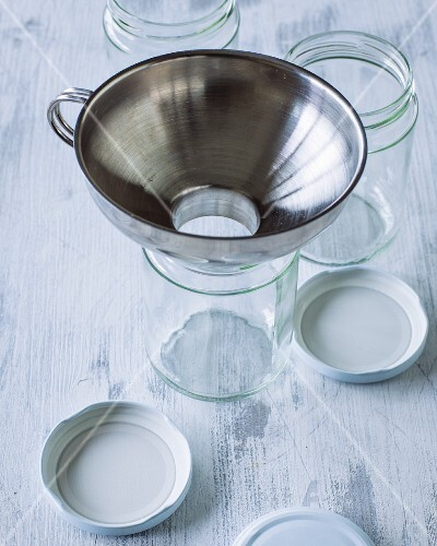A funnel with a wide opening for storage jars
